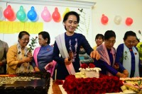 Suu Kyi cuts the cake at her 70th birthday celebrations in Naypyidaw. (PHOTO: DVB).