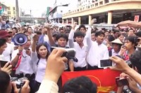 Activists rallied in downtown Rangoon on 30 June calling for the resignation of military MPs. (PHOTO: DVB TV screenshot).