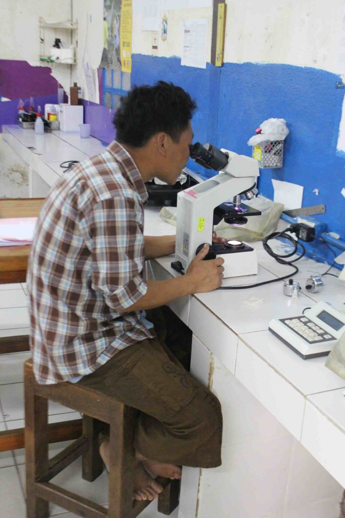 Man at work in lab of Mae Tao Clinic. (Photo: Libby Hogan)